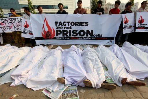 FILE -  Bangladeshi social organisation, Magic Movement, organize a gathering of symbolic dead bodies as a protest against the deaths of the garments workers in the Ashulia fire in front of the Bangladesh Garment Manufacturers and Exporters Association (BGMEA) office in Dhaka, Bangladesh 29 November 2012.  EPA