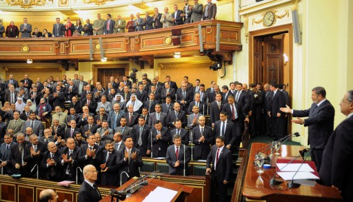 File photo of President Mohamed Morsi (2-R)beeing greeted by Members of Parliament, at the Shura Council, in Cairo, Egypt, 29 December 2012. EPA/EGYPTIAN PRESIDENCY