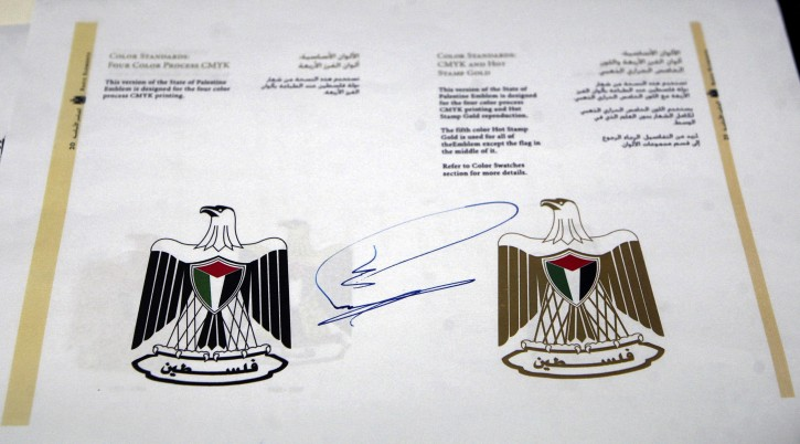 A photograph provided by the Palestinian Authority on 05 January 2013 shows the decree adopting the name State of Palestine and its logo to be used on official documents from the Palestinian Authority after it was signed by Palestinian Authority President Mahmoud Abbas, in the West bank town of Ramallah, on 03 January 2013.  EPA/THAER GANAIM/ALESTINIAN