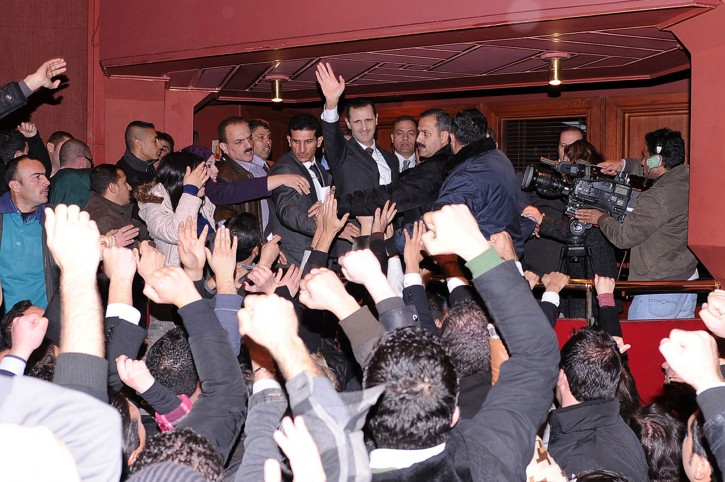 A handout photograph made available by the official Syrian Arab News Agency (SANA) shows Syrian President Bashar Al Assad (C) waving to supoorters after delivering a speech in Damascus, Syria, 06 January 2013. EPA/SANAHANDOUT
