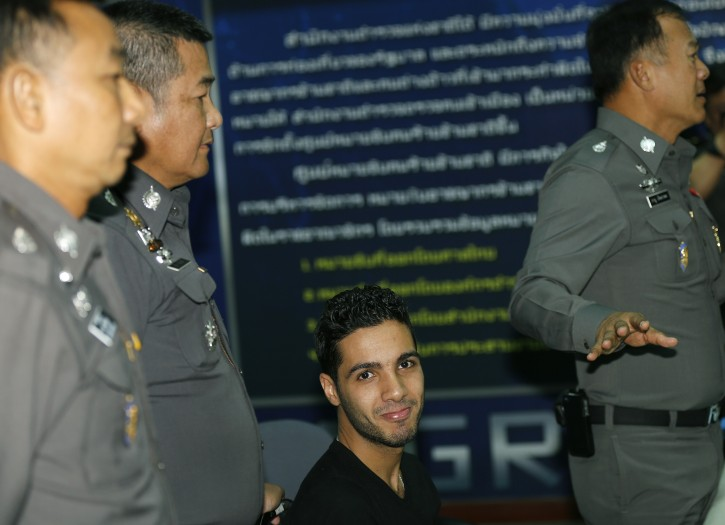 Alleged hacker suspect and on the FBI's top ten most wanted list, Algerian national Hamza Bendelladj, 24, (C) looks on between Thai police officers during a press conference at the Immigration Bureau in Bangkok, Thailand, 07 January 2013. EPA/NARONG SANGNAK