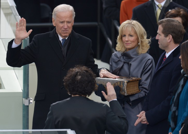 US Vice President Joe Biden (L) places his hand on a bible held by his wife Dr. Jill Biden (C) as he takes the ceremonial oath of office from Supreme Court Justice Sonia Sotomayor (2nd L). EPA/JUSTIN LANE