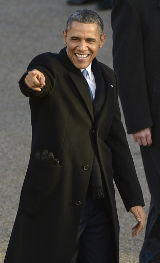 US President Barack Obama points to the crowd as he walks down Pennsylvania Avenue during the Inaugural parade after he was sworn in for a second term as the 44th President of the United States in Washington, DC, USA, 21 January 2013. EPA/TANNEN MAURY