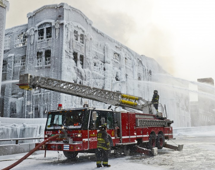 Firefighters battle a multi alarm fire at an abandoned warehouse in sub-freezing temperatures in Chicago, Illinois, USA, 24 January 2013. The five-alarm fire started on 22 January and hot spots have continued to flare up since then. According to officials a third of Chicago's fire fighting force have been involved in working the fire. The warehouse formerly housed a lamp manufacturing business.  EPA/TANNEN MAURY