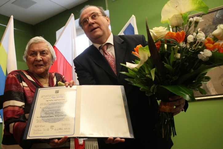 Ambassador of Israel to Poland Zvi Rav-Ner (R) and Stanislawa Wlodarz (L) during the ceremony of granting the Honorary Citizenship of Israel to Mrs. Wlodarz, the Righteous Among the Nations, in Czestochowa, Poland, 29 January 2013. During the Second World War Stanislawa Wlodarz and her parents lived in a village of Cykarzew, near Czestochowa. Risking their lives for two years they were hiding and taking care of Mosze Lichterem and his cousin Mordechaj Lichterem who had escaped from a transport to Treblinka Extermination Camp.  EPA/WALDEMAR DESKA