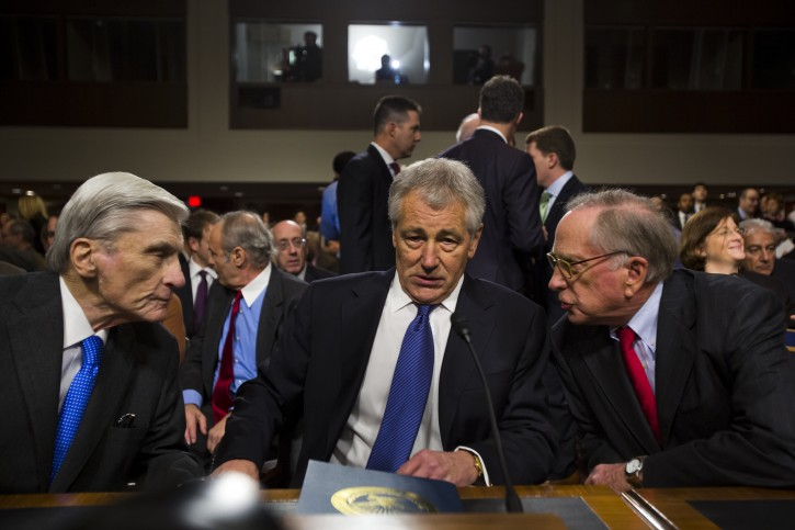 Former Republican Senator from Nebraska, Chuck Hagel (C) flanked by former Senators Sam Nunn (R) and John Warner (L), prepares to testify before the Senate Armed Services Committee on his nomination for the post of Secretary of Defense in the Dirksen Senate Office Building on Capitol Hill in Washington, DC, USA, 31 January 2013. If confirmed, Hagel, who was wounded twice in Vietnam, will be the first enlisted man to serve as Defense Secretary.  EPA/JIM LO SCALZO