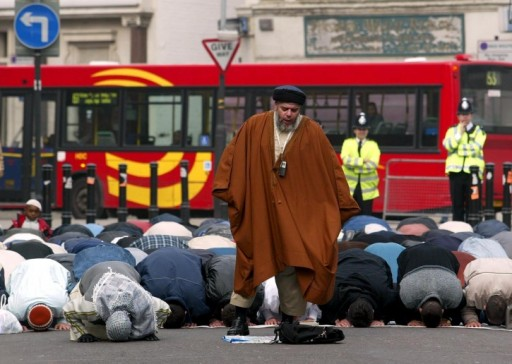 File photo of Muslim Cleric Abu Hamza gives a pray meeting, 28 March 2003, from the street outside a North London Mosque after being banned from the Mosque for inciting racial hatred. It may be Hamza's last meeting as a new bill going through Parliament enables citizens with dual nationalality to be deported. <br /> EPA PHOTO / GERRY PENNY