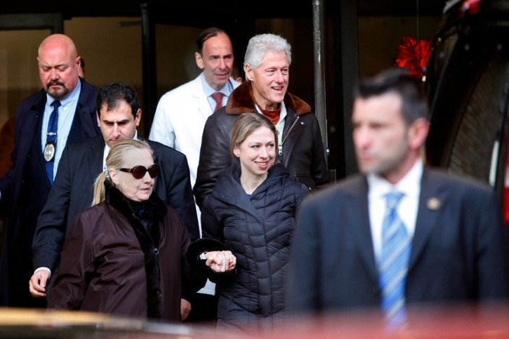 U.S. Secretary of State Hillary Clinton (L) leaves New York Presbyterian Hospital with husband, Bill (TOP), and daughter, Chelsea (C), in New York, January 2, 2013. REUTERS/Joshua Lott