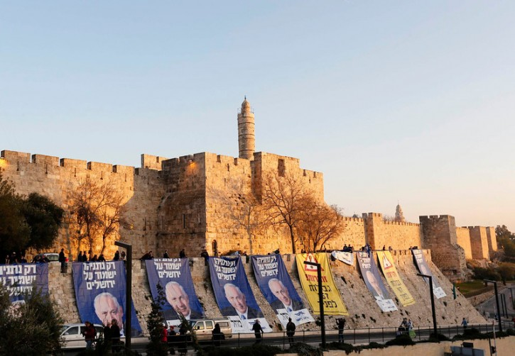 Campaign banners depicting Israel's Prime Minister Benjamin Netanyahu are seen after Likud-Yisrael Beitenu activists draped them on walls surrounding Jerusalem's Old City January 20, 2013. REUTERS/Ronen Zvulun