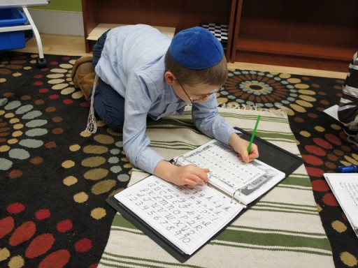 Hard at work at Lamplighters Yeshivah in Crown Heights. Unlike many of the 84,000 other Jewish parochial students in Brooklyn, students at Lamplighters learn religious and secular subjects side by side.