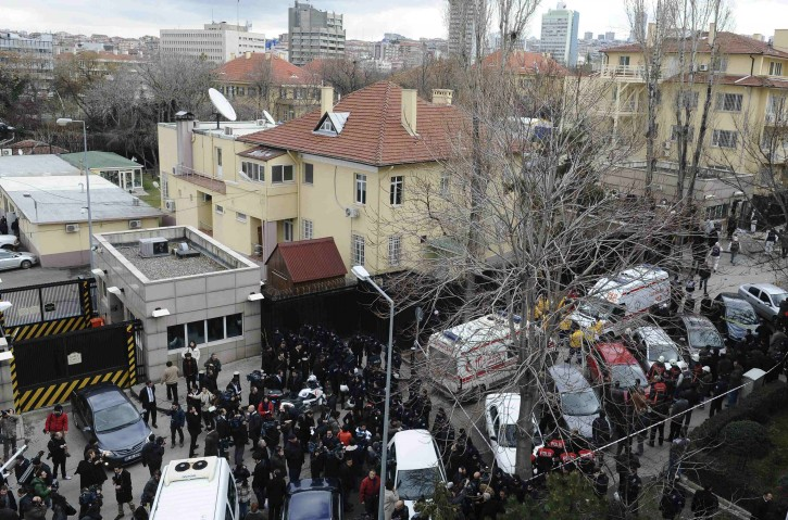 Riot police block a street after an explosion at the entrance (far right) of the U.S. embassy in Ankara February 1, 2013. REUTERS/Stringer