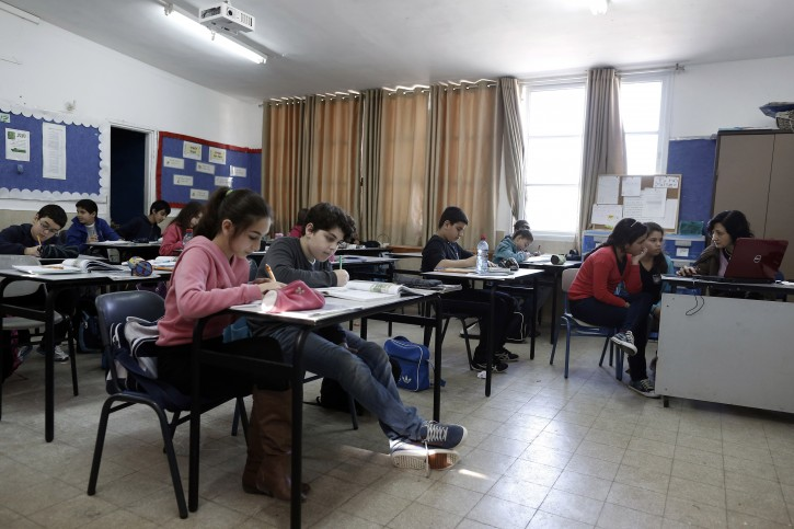 In this Sunday, Feb. 3, 2013 photograph, Israeli students attend a class at Biet Ezekiel elementary school, in the coastal city of Ashkelon. (AP Photo/Tsafrir Abayov)