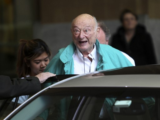 In this Dec. 10, 2012 file photo, former New York City Mayor Ed Koch says goodbye to reporters as he gets in his car after being released from the hospital in New York. (AP Photo/Seth Wenig, File)