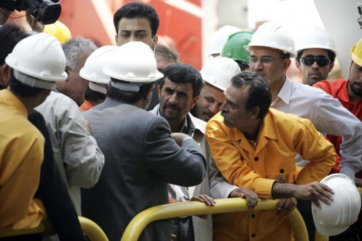 FILE - Iranian President Mahmoud Ahmadinejad (C) listens to the head of state-owned National Iranian Oil Company, Seifollah Jashnsaz, (C-L) while visiting Iran's first offshore oil platform, Iran-Alborz, in the Caspian Sea near city of Neka about 392 km (245 miles) north of Tehran July 23, 2009. REUTERS
