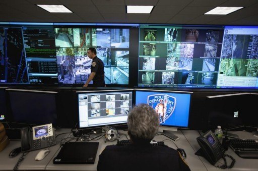 FILE - A New York Police Department officer watches video feeds in the Lower Manhattan Security Initiative facility in New York September 1, 2011.