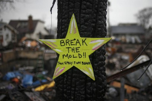 "FILE - A wooden star with the words ""Break The Mold"", is left in front of a burnt house in Breezy Point, almost a month after the neighborhood was left devastated by Hurricane Sandy, in the New York borough of Queens November 27, 2012. Reuters"