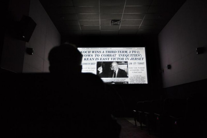 "A man watches the documentary film ""Koch"", about former New York City mayor Ed Koch, at the Angelika Film Center in New York, February 1, 2013. Koch, the voluble three-term mayor who helped bring New York back from the brink of fiscal ruin in the 1970s and came to embody the city with his wry, outspoken style, died on Friday at the age of 88. REUTERS/Lucas Jackson"