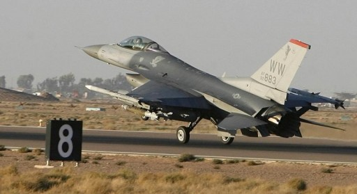 FILE - A U.S. Air Force F16A fighter jet takes off from a U.S. military camp in Balad, 80 km (50 miles) north of Baghdad November 17, 2008.      REUTERS/Erik de Castro