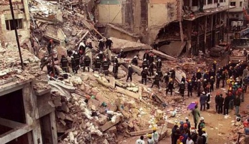 This file photo shows rescue workers searching through the rubble of the Buenos Aires Jewish Community center after a deadly bombing on July 18, 1994. (Photo Credit:AP)