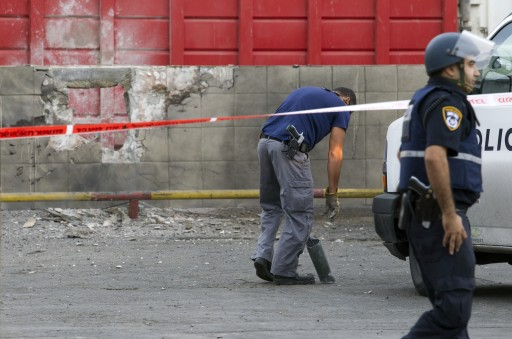FILE -  Israeli police sappers remove a pipe from an exploded missile that slammed into a factory wall in the southern Israeli town of Sderot, 11 November 2012 . EPA