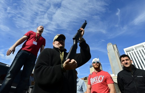 FILE -  Derek Ringley, a second amendment supporter, auctions off a gun  in Dallas, Texas, USA, 19 January 2013. EPA