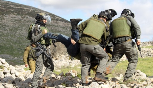 FILE - Israeli soldiers arrest a Palestinian activist near the West Bank village of Burin near Nablus, 02 February 2013, as they break up a peaceful rally opposing the expansion of Israeli settlements on Palestinian lands, according to reports.  EPA/ALAA BADARNEH