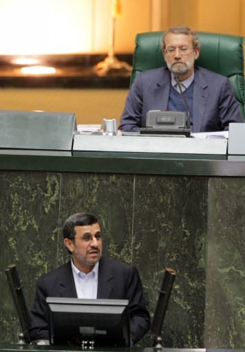 Iranian president Mahmoud Ahmadinejad (below) delivers his speech during the summoning of the labor minister as parliament speaker Ali Larijani (top) listens, at the parliament in Tehran, Iran, 03 February 2013. EPA/STRINGER