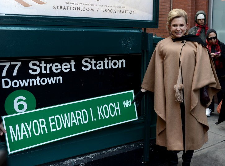 US Congresswoman Carolyn B. Maloney (Democrat - Manhattan, Queens, Brooklyn) stands next to a sign proposing a name change to the 77th Street subway station in honor of former New York City Mayor Edward in New York, New York, USA, 04 February 2013. Koch was a three term mayor of New York City who died last week at the age of 88  EPA/ANDREW GOMBERT