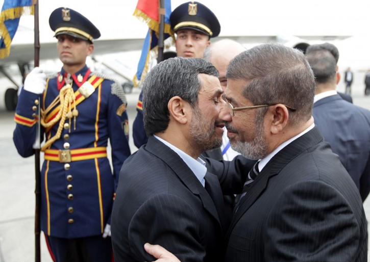 A handout picture made available by Iranian President Mahmoud Ahmadinejad's official website shows Egyptian President Mohamed Morsi (R) greeting President Ahmadinejad (2-R) at the airport in Cairo, Egypt, 05 February 2013. Ahmadinejad arrived in Cairo in the first visit by an Iranian head of state to Egypt in more than 30 years. He is leading the Iranian delegation to a summit of the Organization of Islamic Cooperation, which starts in the Egyptian capital on 06 February.  EPA/AHMADINEJAD