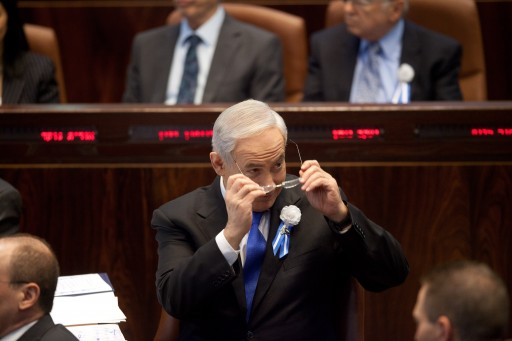 Israel's Prime Minister Benjamin Netanyahu (C) attends the swearing-in ceremony of the 19th Knesset, the new Israeli parliament, in Jerusalem, Israel, 05 February 2013.  EPA/URIEL SINAI