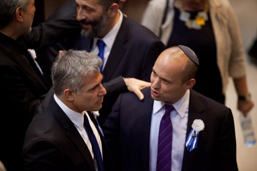 Yair Lapid (L) leader of the Israeli Yesh Atid party and Naftali Bennett (R), head of Israel's Jewish Home party attend the swearing-in ceremony of the 19th Knesset, the new Israeli parliament, in Jerusalem, Israel, 05 February 2013. EPA/URIEL SINAI / POOL