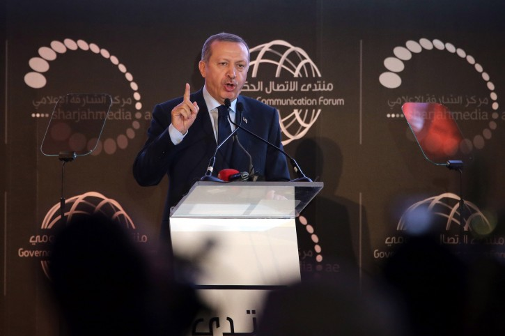 Turkish Prime Minister Recep Tayyip Erdogan gestures as he gives his speech during the opening ceremony of the second edition of Government Communication Forum (GCF) 2013 in Gulf emirate of Sharjah, United Arab Emirates, 24 February 2013.  EPA