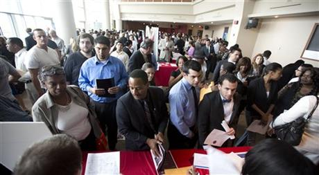 Job seekers fill a room at the job fair in Sunrise, Fla. (AP Photo/J Pat Carter)