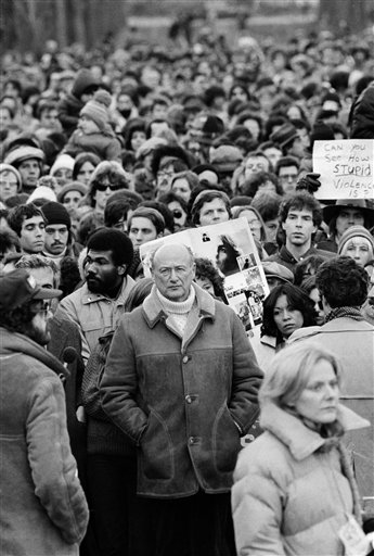 In this Dec. 14, 1980, file photo, New York Mayor Ed Koch stands among Beatles' fans paying tribute to the late John Lennon during a silent vigil that was called by Mayor Koch in New York's Central Park. (AP Photo/Rene Perez, File)