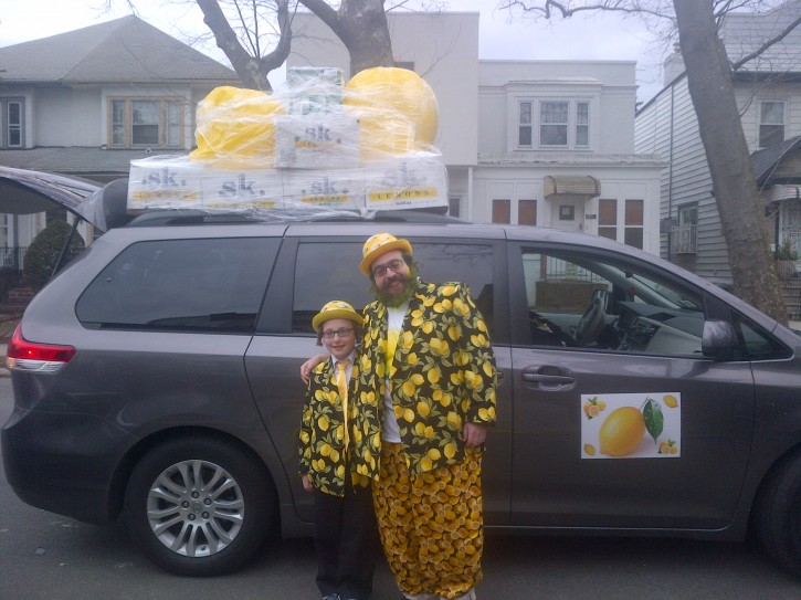In this Feb. 24 2013 photo, a brooklyn family dressed up as lemons. The Lemons delivering shaloch monos in thier lemonzine