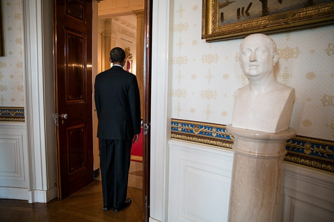 President Barack Obama waits as he is introduced for an event in the Blue Room of the White House, Feb. 1, 2013. A bust of Christopher Columbus is seen at right. (Official White House Photo by Pete Souza)