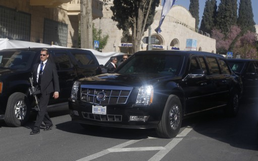 One of U.S. President Barack Obama's limousines is pictured alongside a member of Israeli security outside his hotel in Jerusalem March 21, 2013. REUTERS/Jason Reed