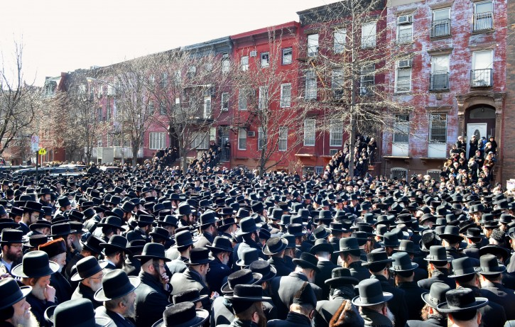 In this March 3, 2013, photo provided by VosIzNeias.com, Orthodox Jewish mourners gather outside the Congregation Yetev Lev D'Satmar synagogue in Brooklyn's Williamsburg neighborhood for the funeral of two expectant parents who were killed in a car accident early Sunday, in New Yorkl. (AP Photo/VosIzNeias.com, Eli Wohl)