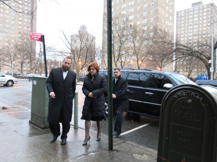 Speaker Council Christine Quinn arrives at the residence of the Zilberstein family to pay a shiva call on Mar. 7 2013. Quinn is being escorted by Ezra Friedlander to their apartment where the shiva visit took place. Photo: Heshy Rubinstein from Dee Voch.