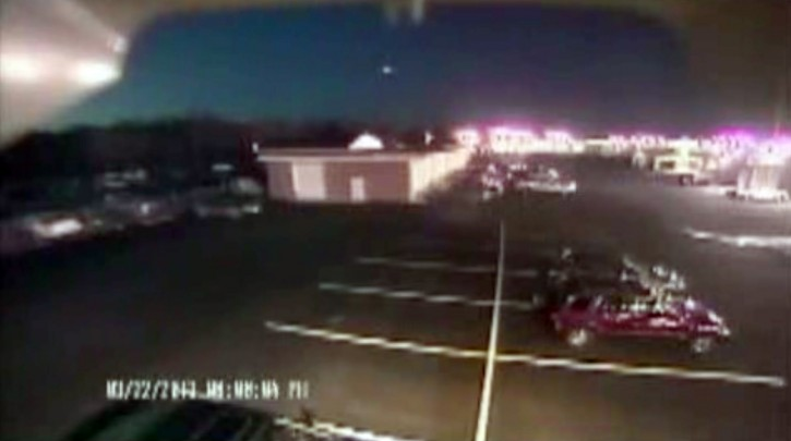 "In this image taken from video provided by Tom Hopkins of Hopkins Automotive Group, a bright flash of light, top center, streaks across the early-evening sky in what experts say was almost certainly a meteor coming down, Friday, March 22, 2013 in Seaford, Del. Bill Cooke of NASA's Meteoroid Environmental Office said the flash appears to be ""a single meteor event."" He said it ""looks to be a fireball that moved roughly toward the southeast, going on visual reports."" (AP Photo/Hopkins Automotive Group)"