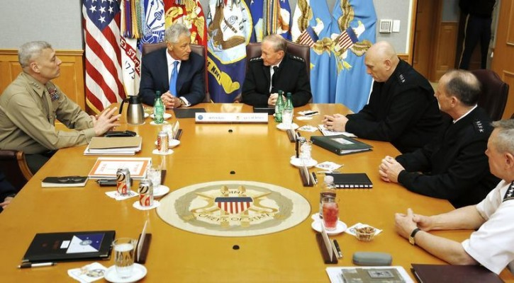 "U.S. Secretary of Defense Chuck Hagel (2nd L) holds his first meeting with the Joint Chiefs of Staff U.S. Marine Corps Commandant General John M. Paxton, Jr. (L), U.S. Army General Martin Dempsey (4th R), General of the Army Ray Odierno (3rd R), U.S. Navy Chief of Naval Operations Admiral Jon Greenert (2nd R) and U.S. Army General Frank Grass (R) in a briefing room called ""The Tank"" at the Pentagon in Arlington, Virginia, March 1, 2013.  REUTERS/Jonathan Ernst"