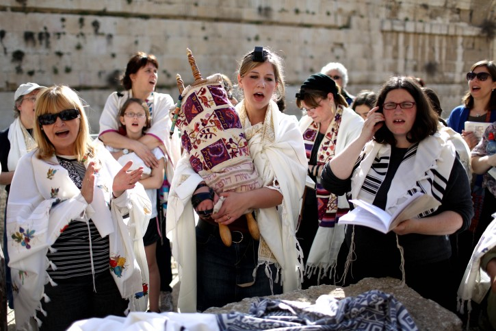 An Israeli Jewish woman carries a Torah scroll (C) during a prayer session near the Western Wall in the Old City of Jerusalem, Israel, 12 March 2013. EPA/ABIR SULTAN