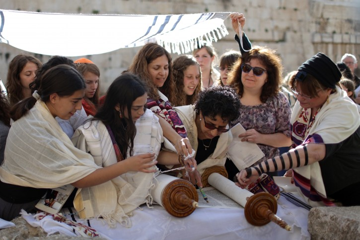 Israeli Jewish women read from a Torah scroll during a prayer session near the Western Wall in the Old City of Jerusalem, Israel, 12 March 2013. EPA/ABIR SULTAN