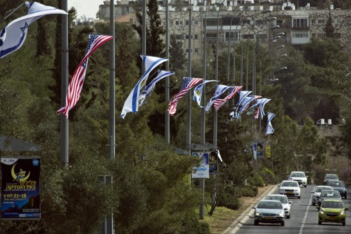 A view of Israeli, Jerusalem and USA flags in place in Jerusalem, 12 March 2013 on part of a route in the city that US President Barak Obama will travel on during his three-day visit, which starts on March 20, 2013. EPA/JIM HOLLANDER