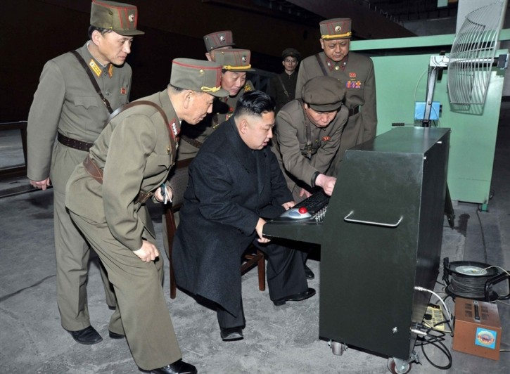 Kim Jong Un gets to grips with North Korean army's latest technology made by unit 1501 of the Korean People's Army, during his visit to the unit on March 24, 2013.<br /> KCNA via Reuters