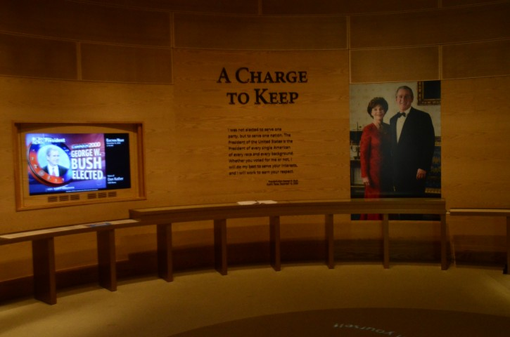 In this photo taken April 16, 2013, a portion an exhibit is shown in the museum area at the George W. Bush Presidential Library and Museum in Dallas. The museum uses everything from news clips to interactive screens to artifacts to tell the story of Bush's eight years in office. The George W. Bush Presidential Center, which includes the library and museum along with 43rd president's policy institute, will be dedicated Thursday on the campus of Southern Methodist University in Dallas. (AP Photo/Benny Snyder)
