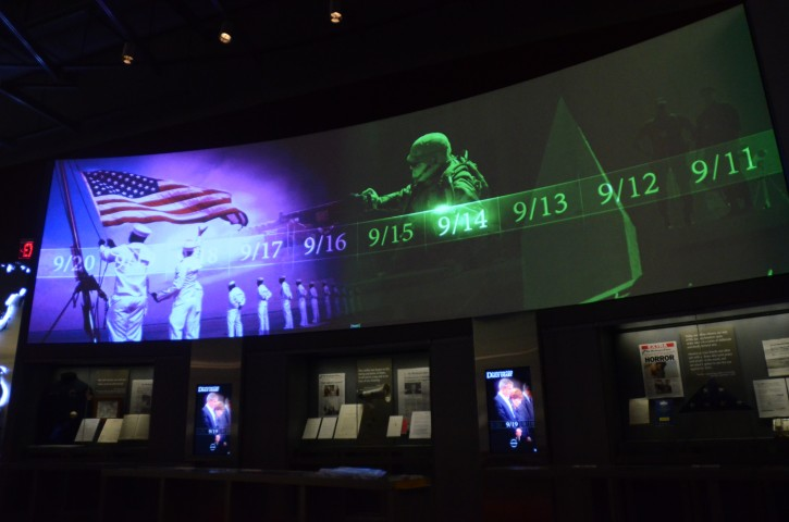 In this photo taken April 16, 2013, a large screen displays images and video of the events and days that followed the 9/11 terrorist attacks as part of an exhibit in the museum area at the George W. Bush Presidential Library and Museum in Dallas.  The museum uses everything from news clips to interactive screens to artifacts to tell the story of Bush's eight years in office. The George W. Bush Presidential Center, which includes the library and museum along with 43rd president's policy institute, will be dedicated Thursday on the campus of Southern Methodist University in Dallas. (AP Photo/Benny Snyder)