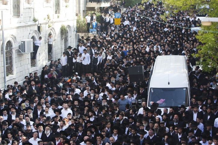 Religious Jews mourn the death of Rabbi Yaakov Yosef, son of the spiritual leader of Israel's ultra-Orthodox Shas party Rabbi Ovadia Yosef, during the funeral in Jerusalem, April 12, 2013. Rabbi Yaakov Yosef died at the age of 66. Photo by Yonatan Sindel/Flash90
