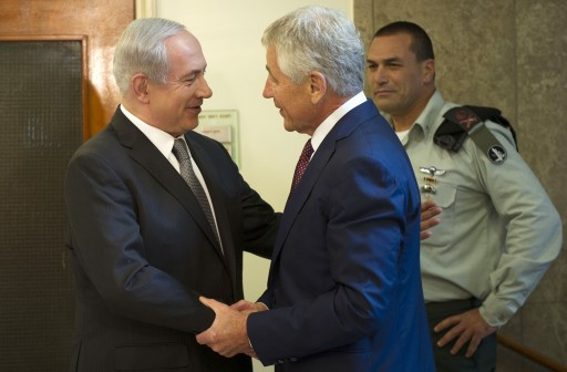 Israeli Prime Minister Benjamin Netanyahu, left, welcomes U.S. Secretary of Defense Chuck Hagel at his office in Jerusalem, on Tuesday, April 23, 2013. (AP Photo/Jim Watson, Pool)