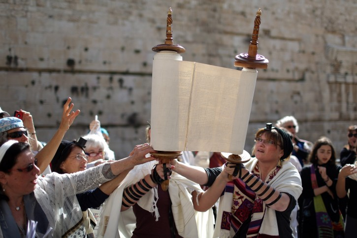Israeli Jewish women open a Torah scroll during a prayer session near the Western Wall in the Old City of Jerusalem, Israel, 12 March 2013. EPA/ABIR SULTAN